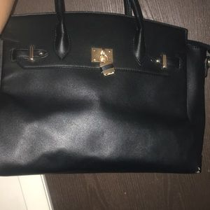 JustFab Leather purse with gold lock accent
